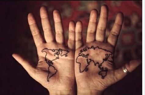 World in the hands tattoo - beautiful travel tattoos