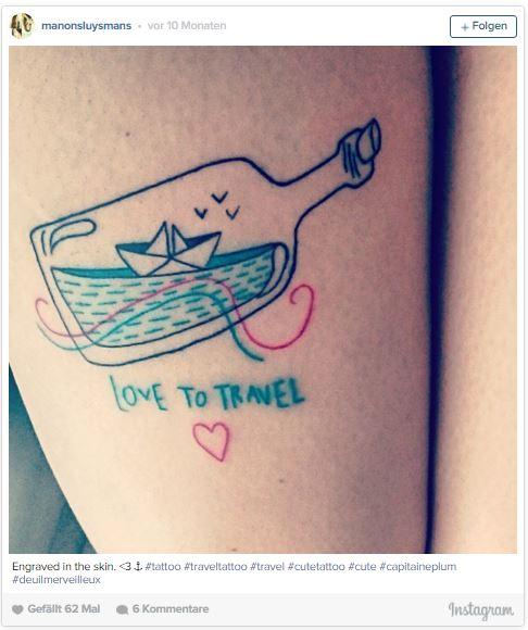 World in a bottle tattoo - pretty travel tattoo